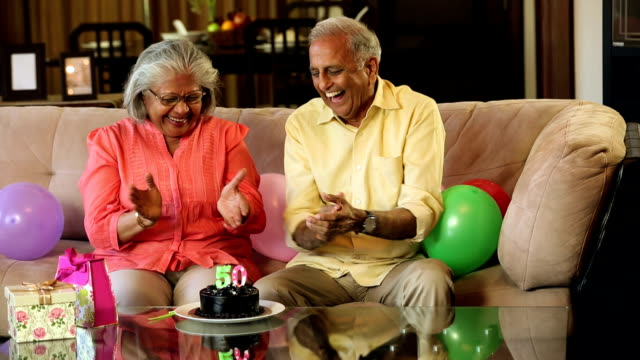 Senior couple celebrating anniversary at home, Delhi, India