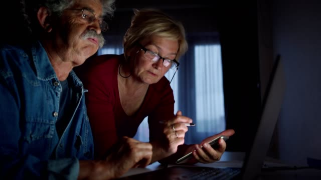 senior couple check bank accounts online - husband stock videos & royalty-free footage