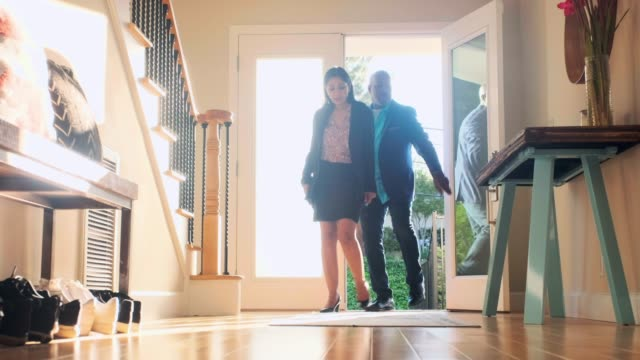 senior couple coming home - front door stock videos & royalty-free footage