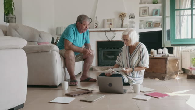 senior couple considering options for changes to home decor - content stock videos & royalty-free footage