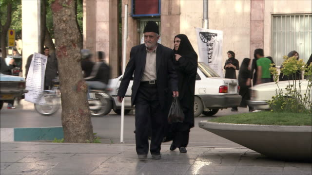 ms senior couple crossing street, isfahan, iran - modest clothing stock videos & royalty-free footage