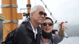 Senior couple cruising on ship during retirement vacation