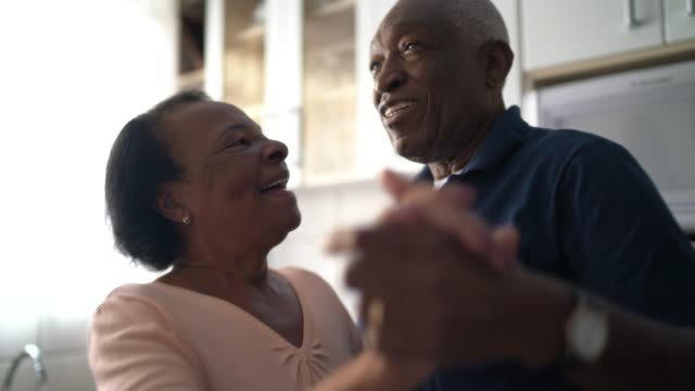 senior couple dancing at kitchen - motivation stock videos & royalty-free footage