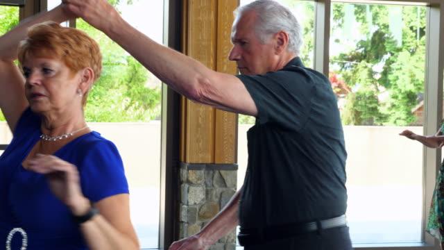MS Senior couple dancing in community center