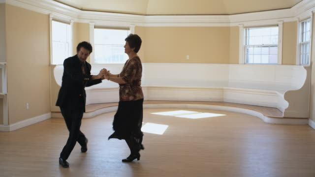 ws, senior couple dancing in empty room, hingham, massachusetts, usa - tango dance stock videos & royalty-free footage