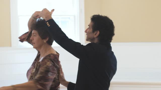slo mo, cu, senior couple dancing in empty room, hingham, massachusetts, usa - ballroom dancing stock videos & royalty-free footage