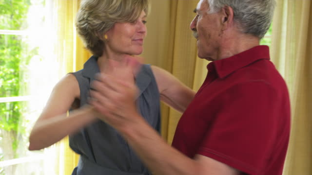 MS Senior couple dancing in living room / Tenafly, New Jersey, USA