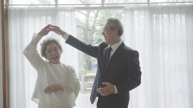 a senior couple dancing in remind wedding - swinging stock videos & royalty-free footage