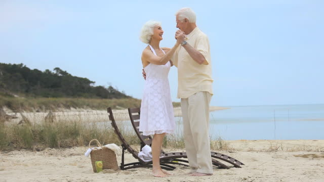 ws pan senior couple dancing on beach, eastville, virginia, usa - eastville stock videos and b-roll footage