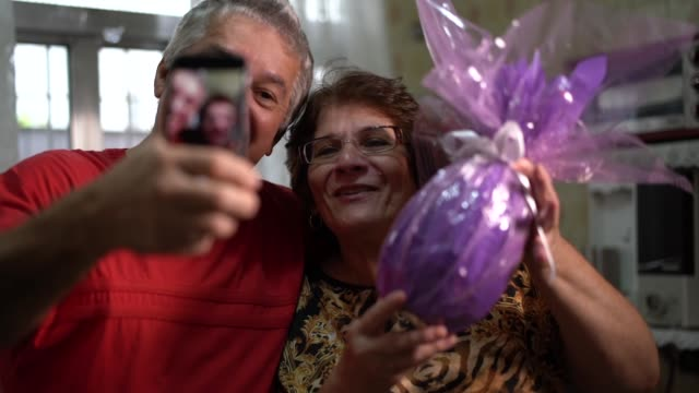 senior couple doing a video chat in brazilian easter - easter stock videos & royalty-free footage