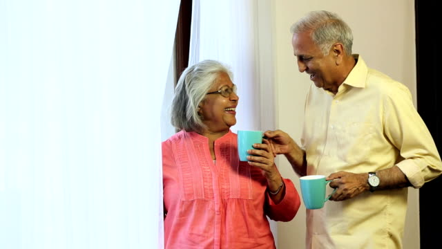 senior couple drinking tea at home, delhi, india - indian couple tea stock videos & royalty-free footage
