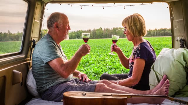 senior couple drinking whine in the back of a camper van - retirement stock videos & royalty-free footage