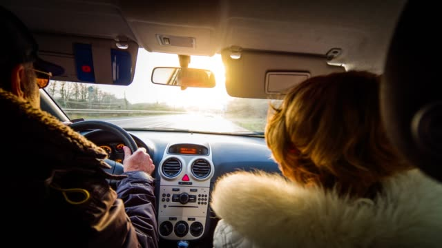 senior couple driving car at sunset - car interior stock videos & royalty-free footage