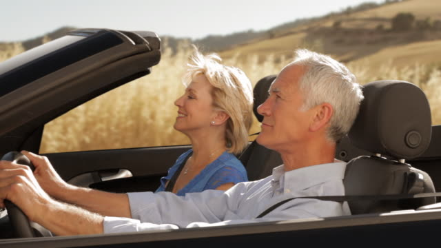 senior couple driving convertible car - convertible stock videos & royalty-free footage