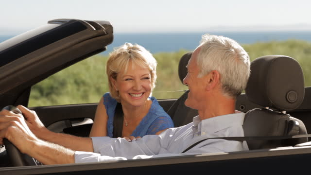 senior couple driving convertible car - old convertible stock videos & royalty-free footage