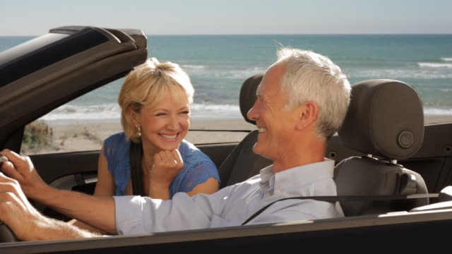 senior couple driving convertible car - 50 54 years stock videos & royalty-free footage