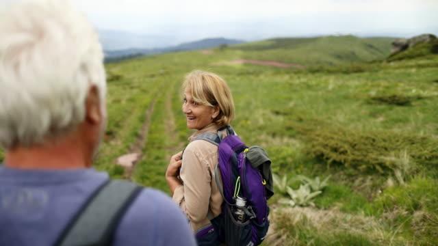 senior couple during hiking - hiking stock videos & royalty-free footage