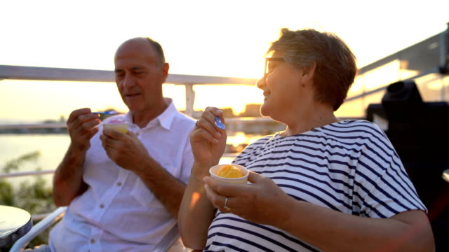 senior couple eating ice cream - senior couple stock videos & royalty-free footage