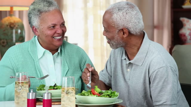 ms ds senior couple eating salad at home dining room table / richmond, virginia, usa - dieting stock videos & royalty-free footage