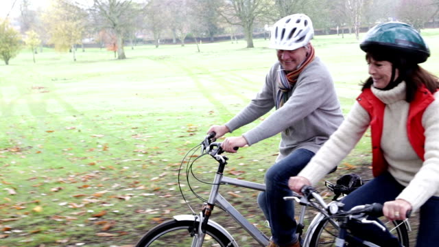 senior couple enjoying a bike ride together - pedal stock videos & royalty-free footage
