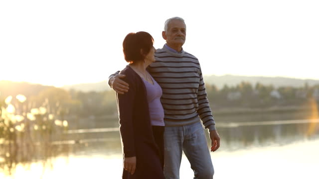 senior couple enjoying autumn day by the lake - pullover stock videos & royalty-free footage