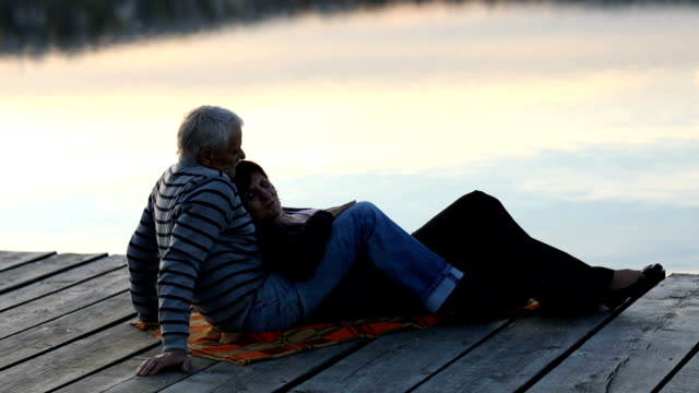 Senior couple enjoying autumn day by the lake