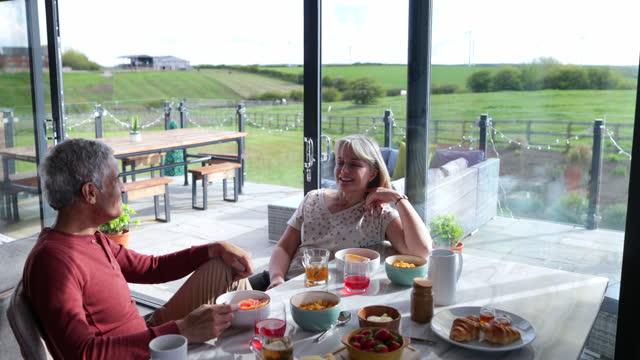 senior couple enjoying breakfast - citrus fruit stock videos & royalty-free footage