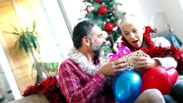 Senior couple enjoying Christmas.