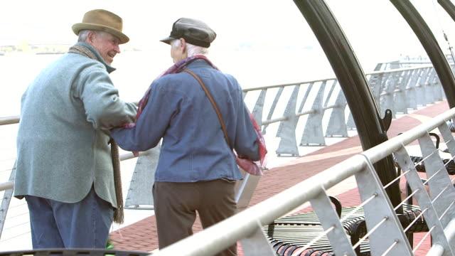 Senior couple enjoying day of shopping, walking, talking