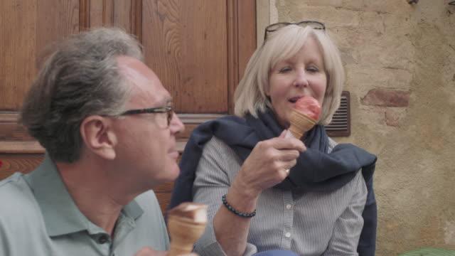 senior couple enjoying icecream on holiday - city break stock videos & royalty-free footage