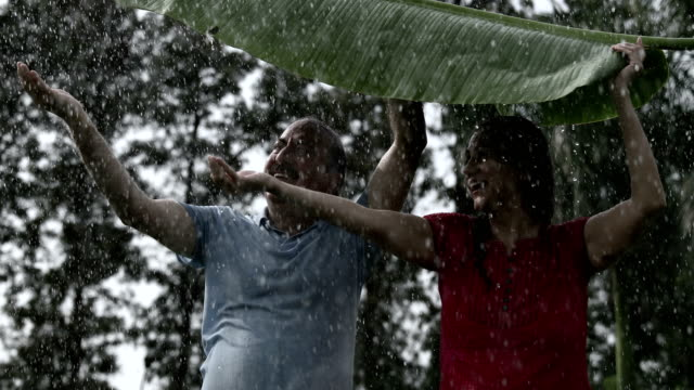 Senior couple enjoying in the rain season, Delhi, India