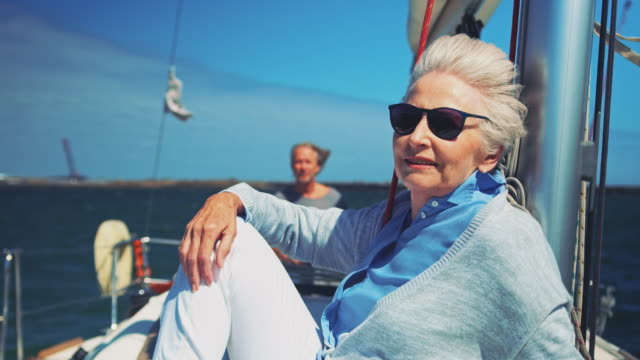 senior couple enjoying in yacht during vacation - adventure stock videos & royalty-free footage