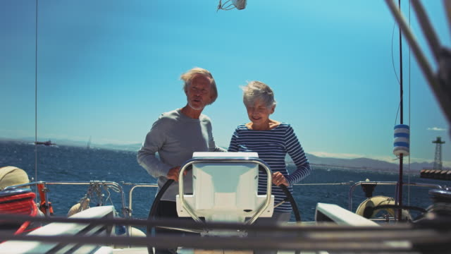 senior couple enjoying marine vacation in yacht - yacht stock videos & royalty-free footage