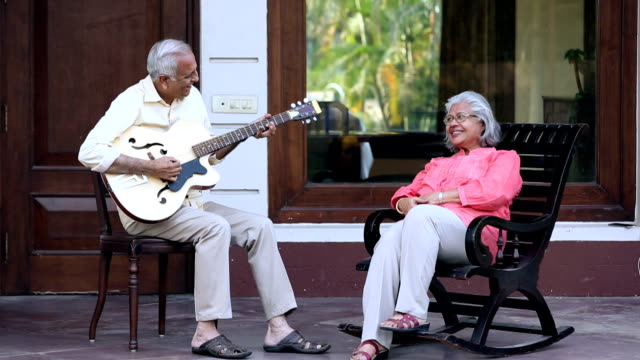 senior couple enjoying music at home, delhi, india - indian subcontinent ethnicity stock videos & royalty-free footage