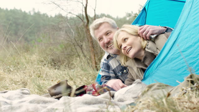 Senior couple enjoying the wilderness from their campsite