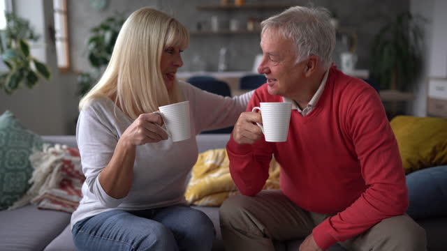 senior couple enjoying their time together while relaxing at home - comfortable stock videos & royalty-free footage