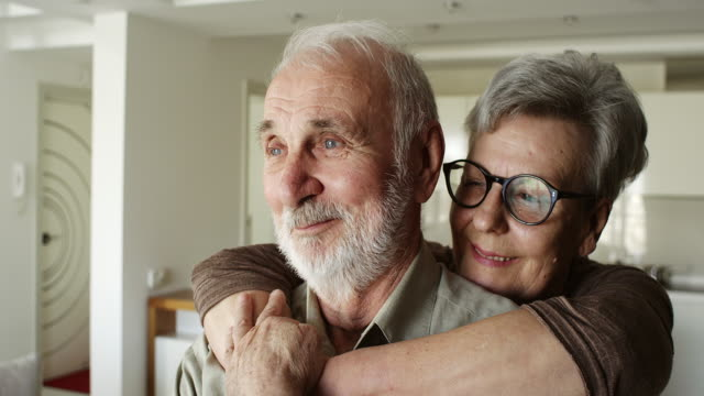 senior couple enjoying time spent together - arm around stock videos and b-roll footage