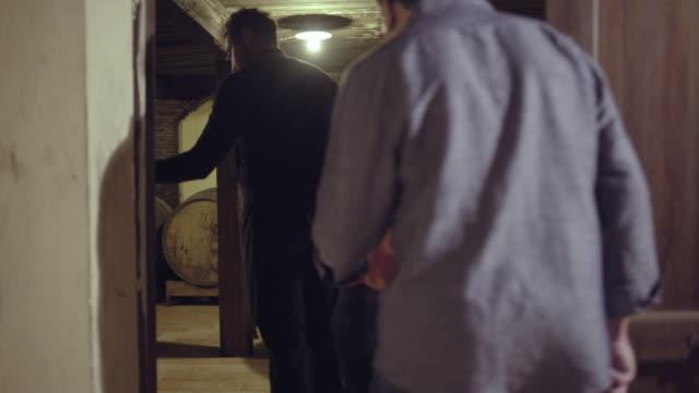 Senior couple entering a wine cellar