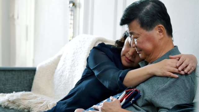 senior couple grieve the loss of their military son - sad old asian man stock videos & royalty-free footage
