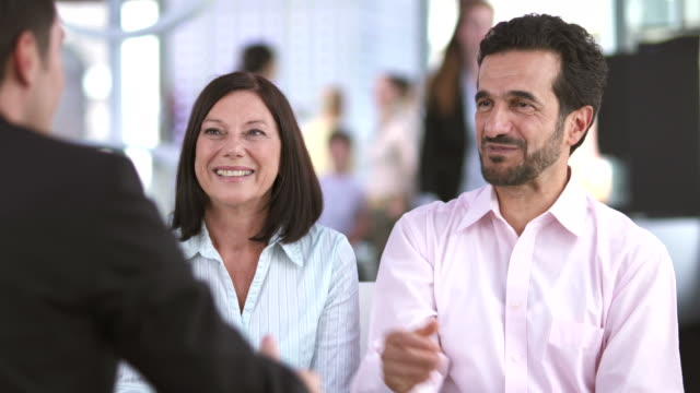 hd: senior couple handshaking in the bank - customer stock videos & royalty-free footage