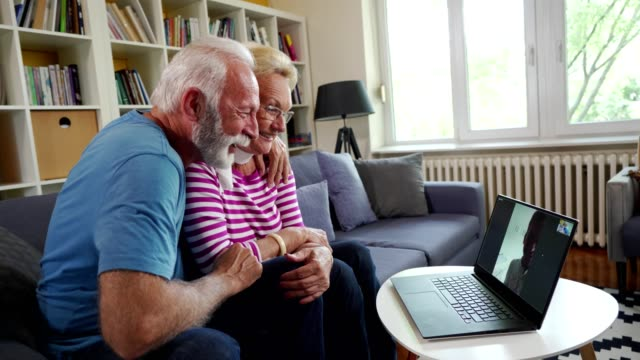 senior couple have a video call with grandson - grandson stock videos & royalty-free footage