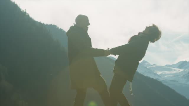 Senior couple having fun on a mountaintop.