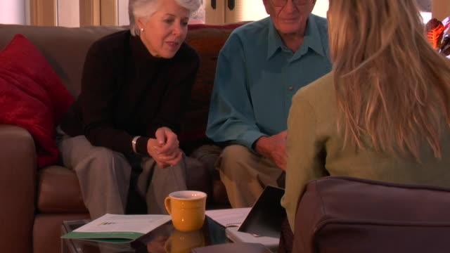 ms, tu, senior couple having meeting with financial advisor, santa fe, new mexico, usa - 説得点の映像素材/bロール
