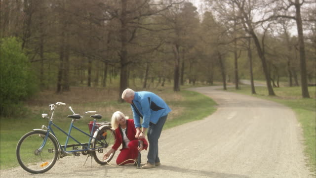 Senior couple having trouble with their tandem, Sweden.