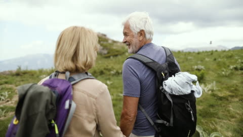 senior couple hiking - hiking stock videos & royalty-free footage