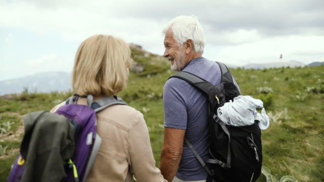 senior couple hiking - senior couple stock videos & royalty-free footage