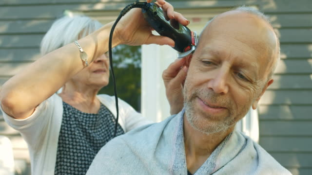senior couple home grooming - hairstyle stock videos & royalty-free footage