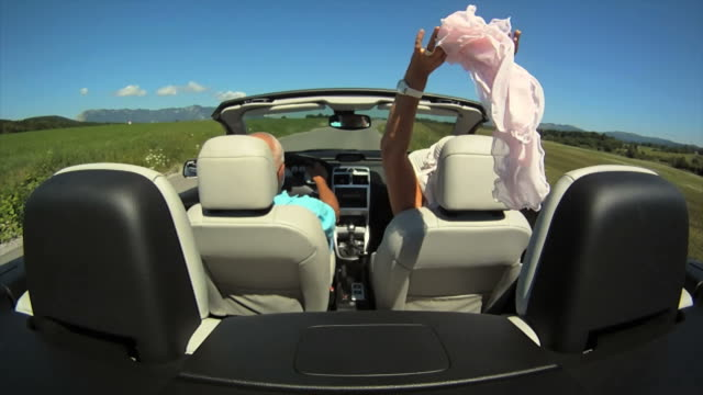 HD SLOW-MOTION: Senior Couple In A Convertible