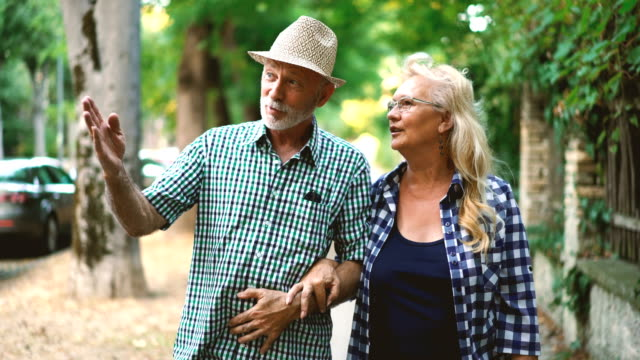 senior couple in a relaxing walk. - senior couple stock videos & royalty-free footage
