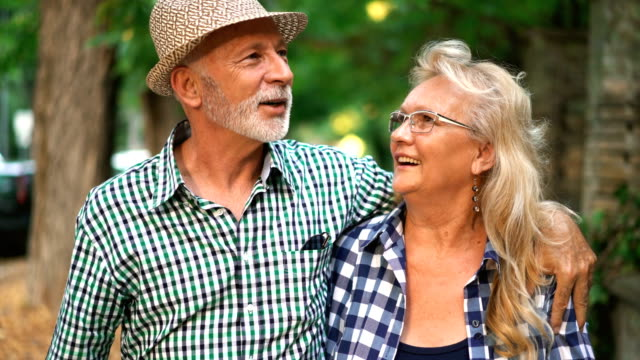 senior couple in a relaxing walk. - carefree stock videos & royalty-free footage